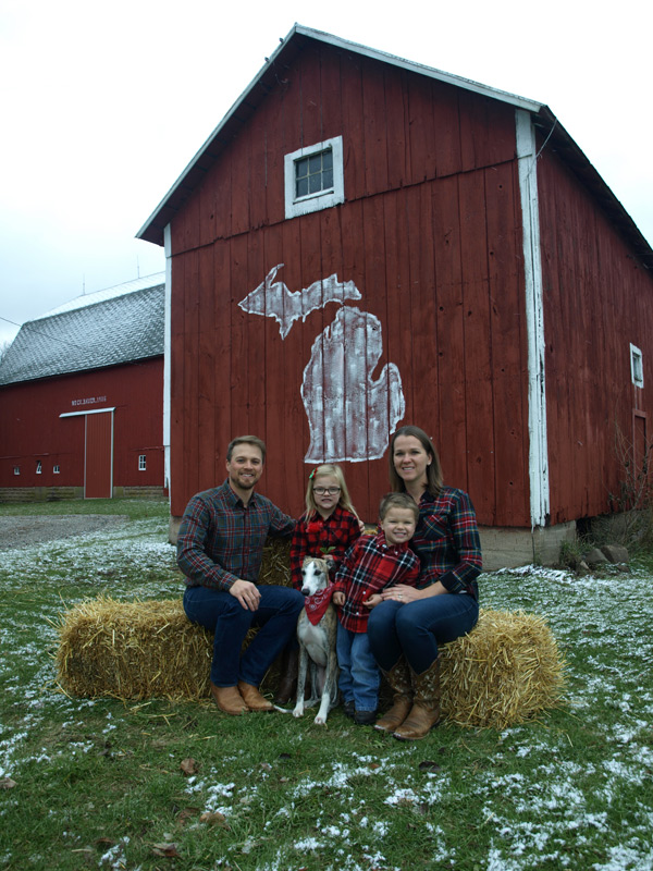 Kate Davis, MS, RD, CSSD, LDN, and family, in front of red barn