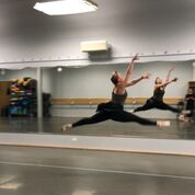 Melissa Joy Dobbins MS, RDN, CDE, in grand jete in ballet studio