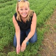 Melissa Joy Dobbins MS, RDN, CDE, in a field