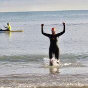 Melissa Joy Dobbins MS, RDN, CDE, finishing triathalon