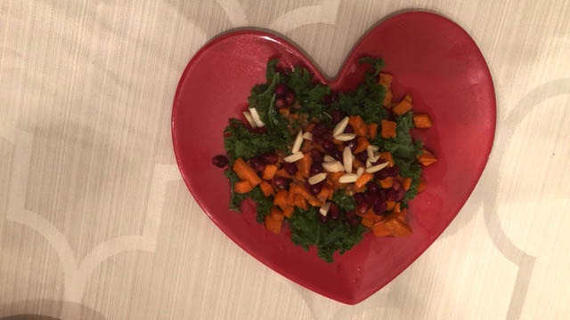 Massaged Kale Salad on a red heart plate for Valentine's Day