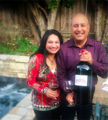 vandana and husband holding wine