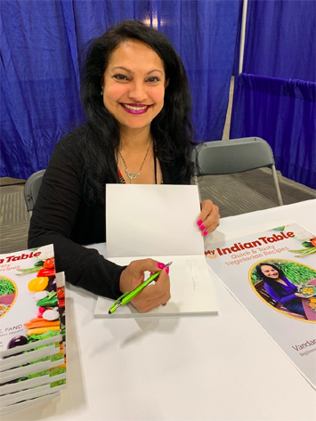 Vandana signing her cookbook